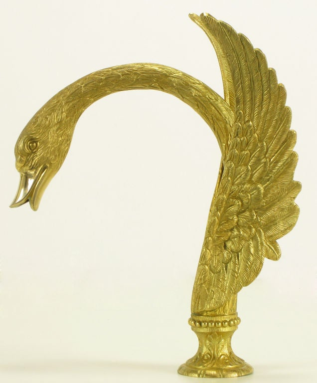 Gold plate over cast bronze swan form faucet by Sherle Wagner. Long neck and open wings create a substantial faucet for the exceptional bath tub.