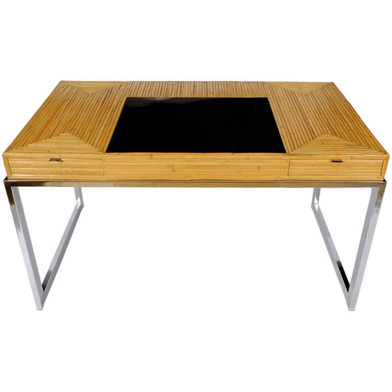 bamboo trestle table with glass top and chrome detail at