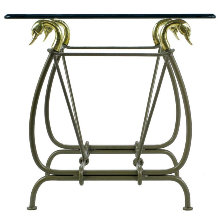 Iron end table surmounted by cast brass swans and glass for Cast iron end table