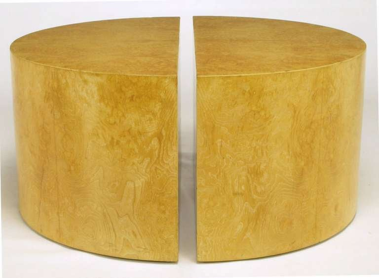 Olive ash burl clad half-circle coffee tables in the manner of Milo Baughman. Can be combined as a single circular coffee table, a pair of demilune coffee tables, as well as a racetrack oval coffee table with the addition of a glass top to span a