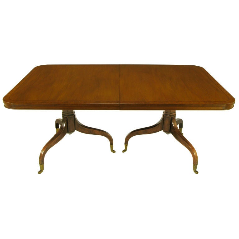 this kittinger mahogany dining table with unusual double pedestals is