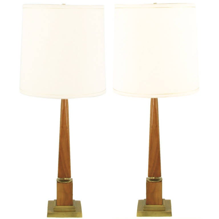 Fine pair of walnut obelisk table lamps with stepped brass plinth bases and recessed brass ferrule detail. Sold sans shades.