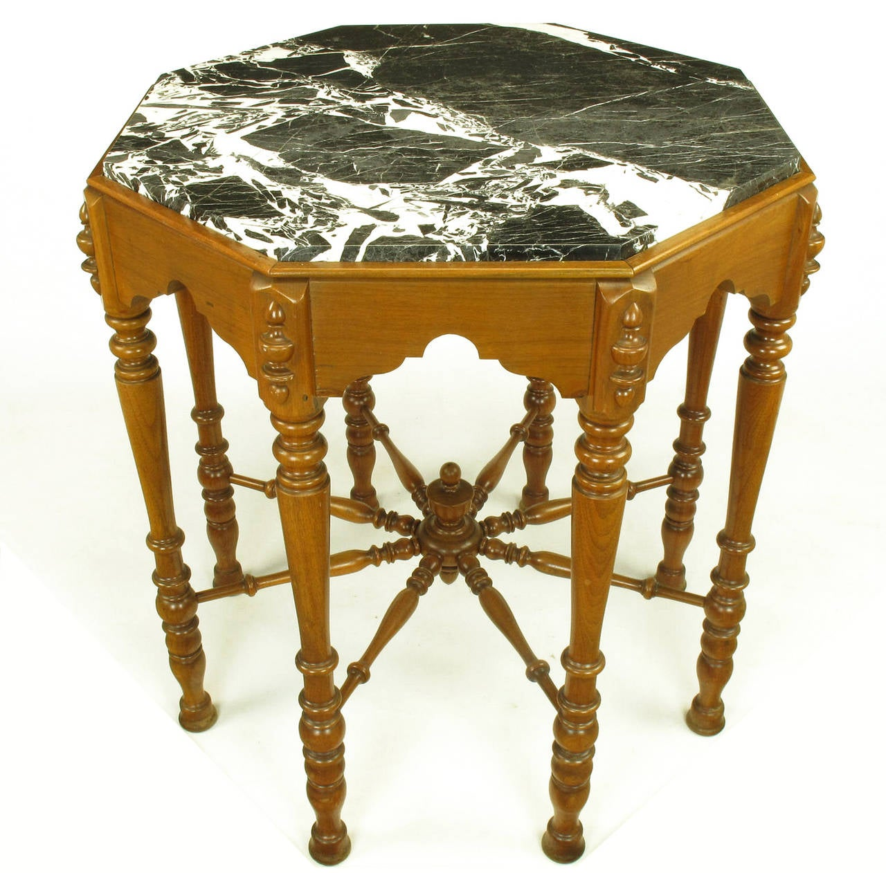 Walnut Eastlake/ Victorian transitional center table or side table with octagonal black and white marble top and eight carved baluster style legs. Ships wheel style center stretcher.