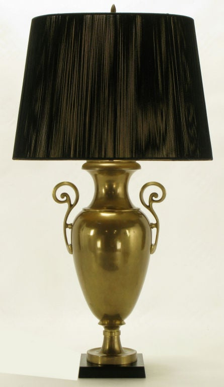 Vintage Chapman lighting urn form table lamp. Solid brass with open fretwork brass handles, and black marble base. Sold sans shade.
