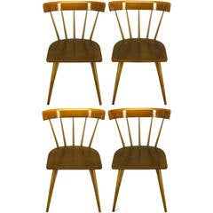 Four Paul McCobb Dark Maple Spindle-Back Dining Chairs
