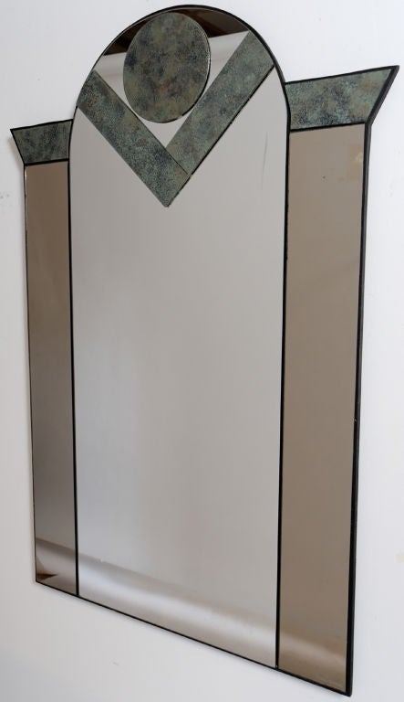 Postmodern, or Art Deco, form mirror, with geometric inserts of patinated bronze, and smoked mirror panels flanking the main mirror.