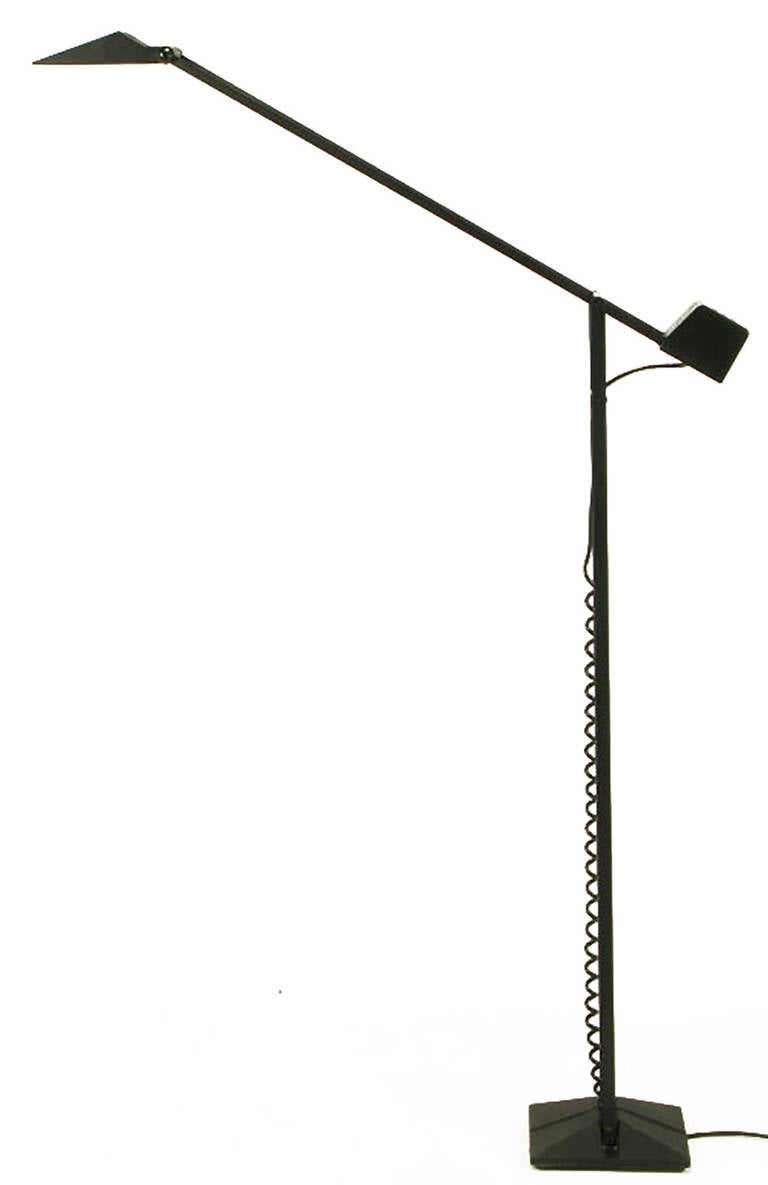 Early textured black lacquered steel and cast iron articulated halogen floor lamp by cutting edge American lighting company Artup. Heavy cast iron base with unexpected coiled cord running from the base to the three switch counterweight transformer,