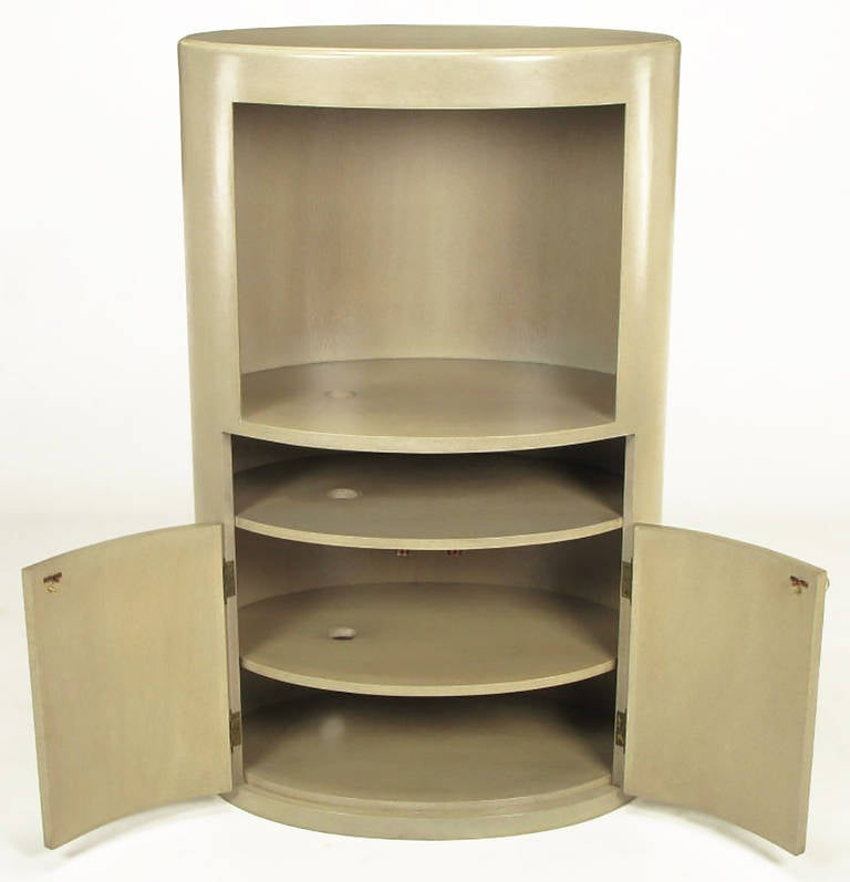 Excellent custom designed driftwood gray glazed birch wood tall oval media cabinet with openings to accommodate component cords. Upper opening measures 20