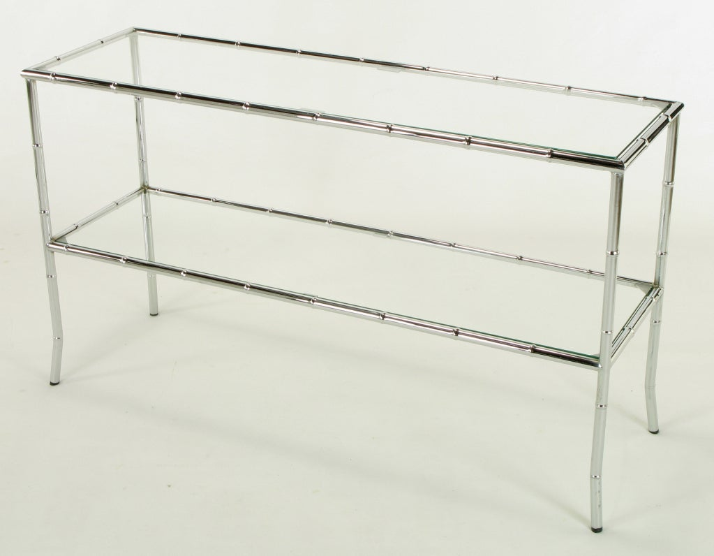 Bamboo form chromed steel console table with two tiers and glass shelves. See our listings for other pieces from this collection.