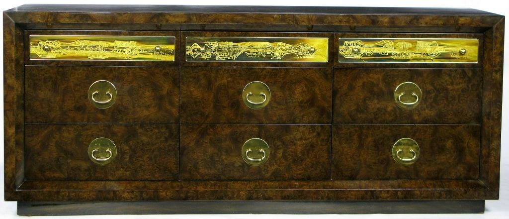Beautifully burled case atop a wood plinth. Nine drawers; three with acid-etched panels and spherical pulls. Six with Asian drop bail pulls, backed by oval brass plates.