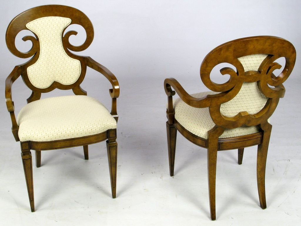 Early work from Mastercraft, this set of six burled amboyna wood chairs are styled after Biedermeier. The seats are upholstered in a textured silk blend, cross hatch patterned fabric in off-white. The two arm chairs have an upholstered back and the