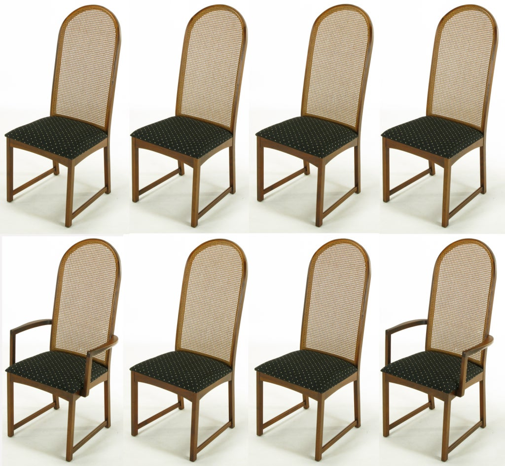Eight milo baughman walnut and cane arched back dining for Cane back dining chairs design