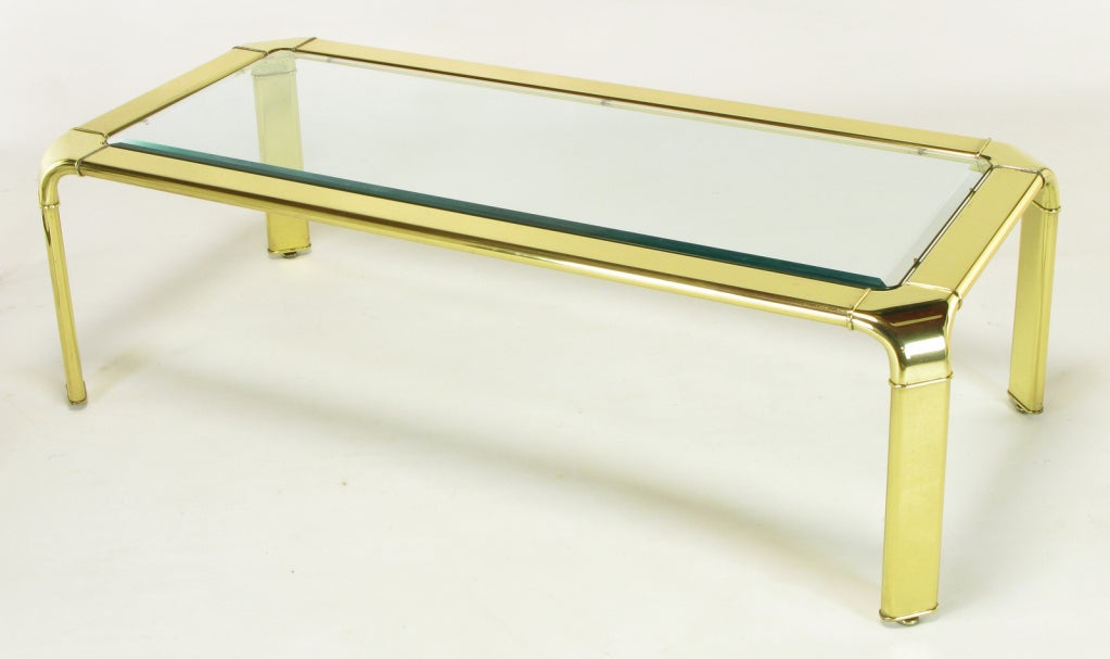 Polished brass frame with canted radius corners and legs from John Widdicomb. Glass top is 3/8