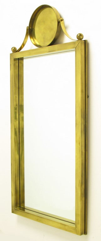 American Large Antiqued Brass Wall Mirror with Circular Brass Pediment For Sale
