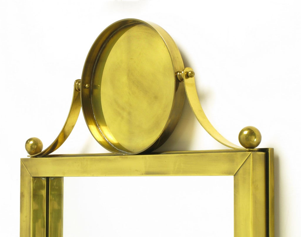 Mid-20th Century Large Antiqued Brass Wall Mirror with Circular Brass Pediment For Sale