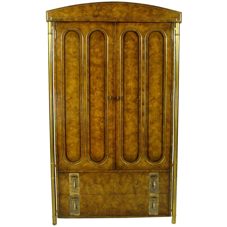 This neoclassical wardrobe cabinet was made by Mastercraft for Charak Furniture, the legendary Boston furniture company that once featured modern designs by Tommi Parzinger. In the mid-1960s, Charak ceased its own production due to labor
