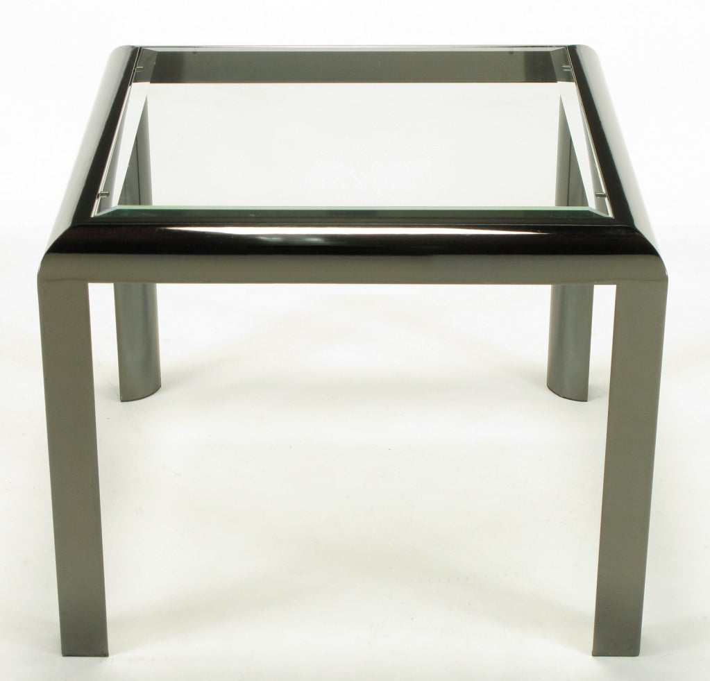 A Parsons style side table with a twist, from Design Institute America. The gun metal finish and radiused corners are also design elements evocative of Karl Springer.