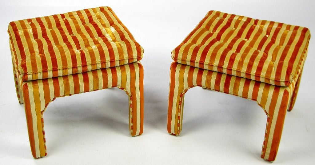 Vibrant pair of fully upholstered square ottomans/benches with a Moroccan flair. The original cream, gold and orange striped velvet upholstery is in great condition.