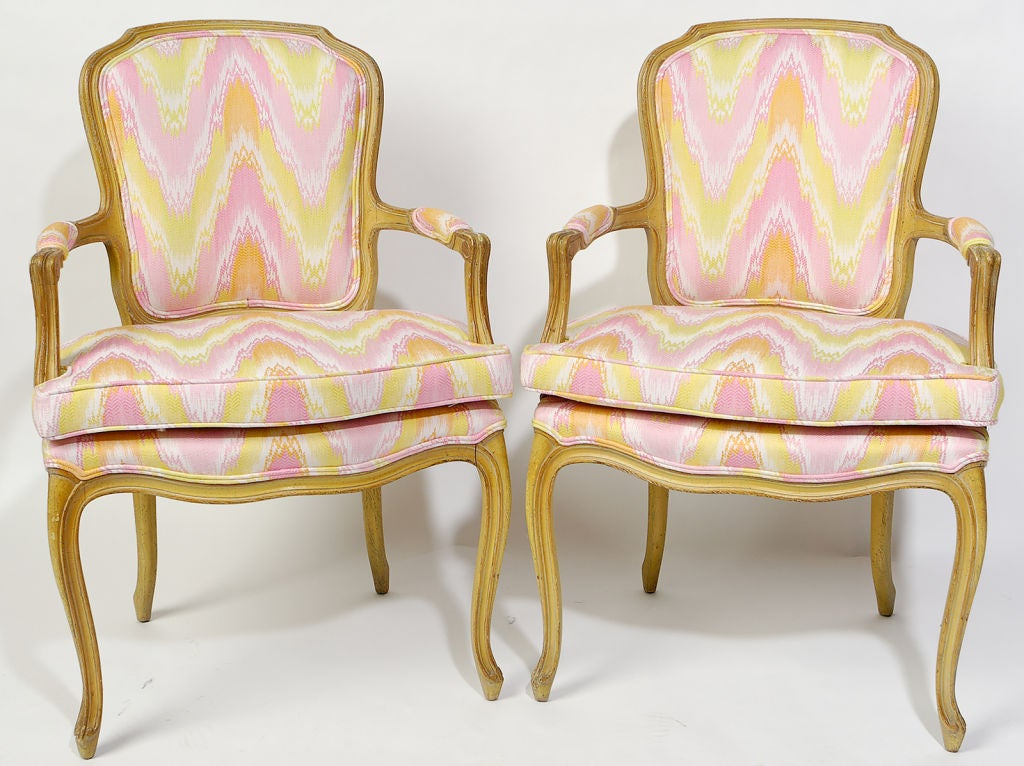 Pair 1940s Louis XV style open armchairs with original yellow and pink painted finish. Newly upholstered in a vintage pink, yellow, white, and apricot flamestitch fabric.