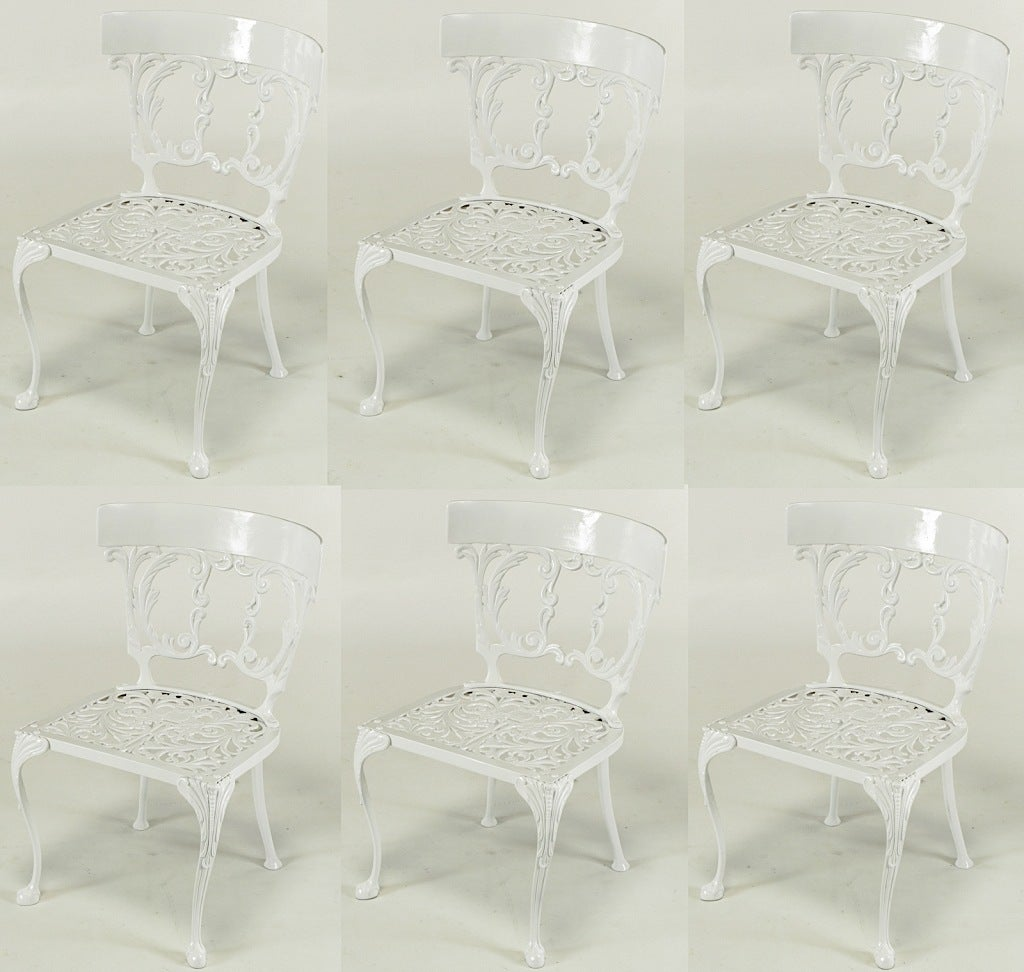 Set of six cast aluminum and white enameled French regency style dining chairs. Fresh white enamel over finely cast aluminum for which Molla was renowned.