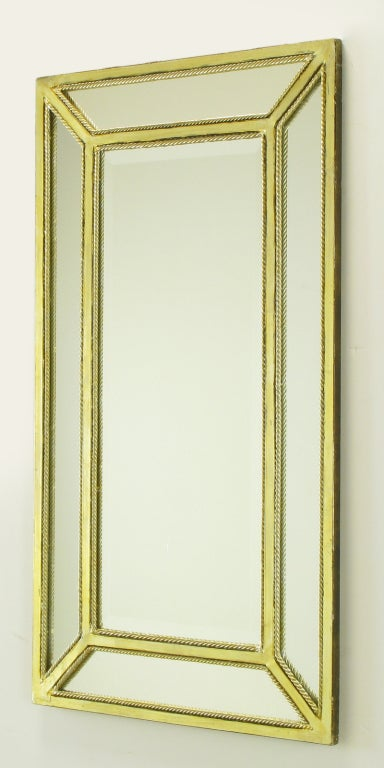 Italian five section mirror with toned silver leaf metal frame and similarly finished metal rope bordered detail. Five mitered edge narrow mirror frames the center beveled mirror. Excellent for the powder room or entry way over a console table.