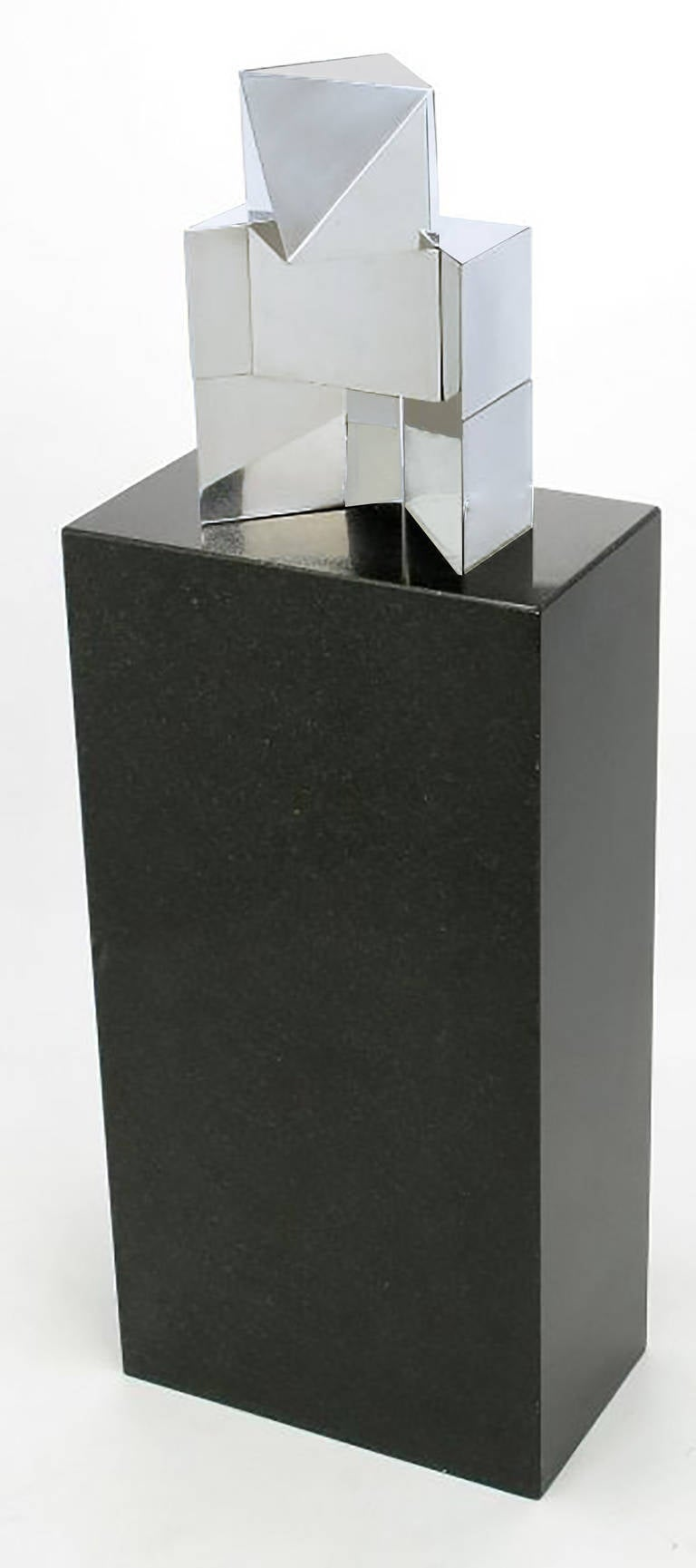 Impressive chromed and incised geometric metal sculpture, on a black granite plinth. Sculpture is signed S. Fernandez Van Den Bussche 1979.