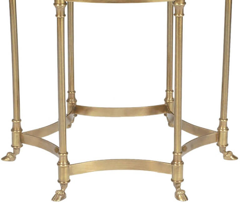 Solid brass Labarge six leg side table with hooved feet. Reverse hexafoil stretcher connected with cuffs and spacers. 1/2