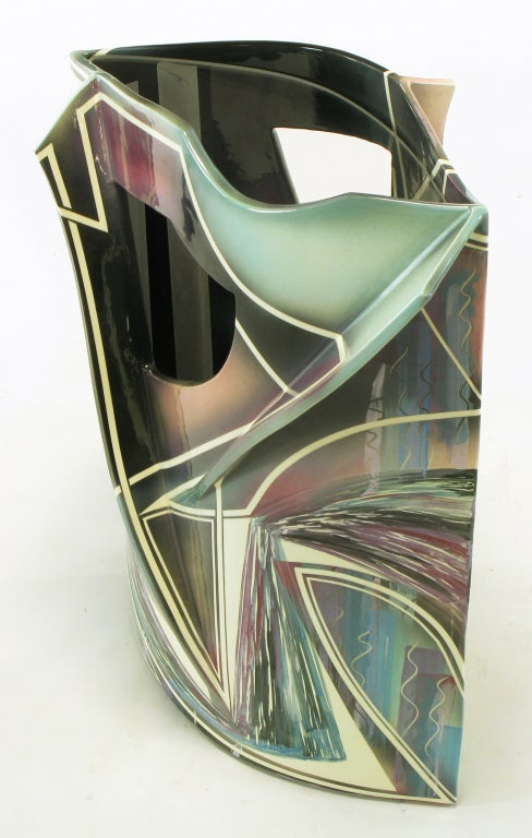 Elliptical shaped ceramic pierced and finned side table with abstract glazed stripes and shapes. Turquoise, magenta, white and black colors glazed in a fluid motion. Glass inset surface. Would also make a striking pedestal. Signed and numbered,
