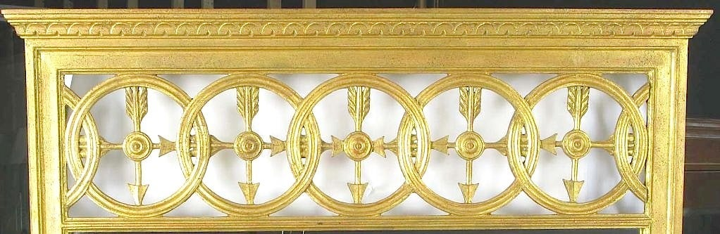A fine and well executed example of Italian Empire design. Open transom featuring interlocking circles and crossed arrows. The frame is carved wood and finished in patinated gilding. Possibly a Fratelli Paoletti of Firenze design.
