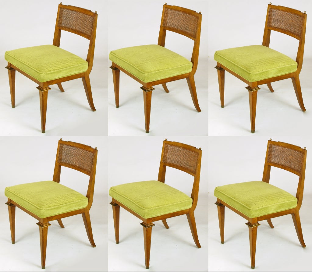 Excellent set of six Empire style dining chairs with original cut velvet chartreuse seats and open cane back. Gilt copper ball finials, front leg capitals and sabots. Nice profile with raked saber style back legs. Possibly early Mastercraft or