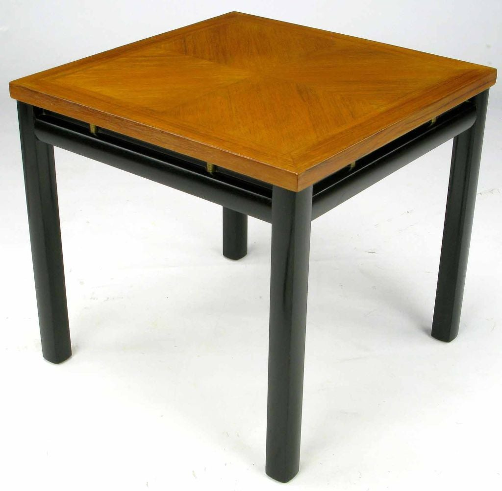 Pair of petite end tables by Michel Taylor for Baker. Bleached mahogany parquetry tops are supported by black lacquered legs and a black lacquered skirt with brass semi cylindrical detail. Would also work if configured as a two-piece coffee table.