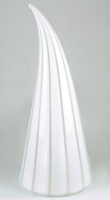Handblown art glass cone table lamp with thick white stripes and alternating thin clear stripes. Internal socket and white lamp cord with on/off switch. Conical glass with curved tip. Open bottom with recessed lip.  Murano, is an island in Venice,