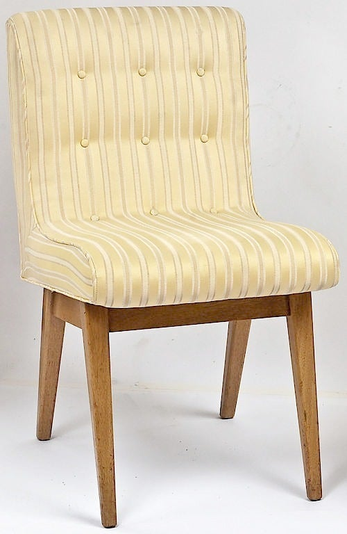 Pair of button tufted side or slipper chairs with upholstered one piece seat that curves into the back. Bleached mahogany wood bases. Striped ivory and white silk upholstery is original. Uncommon base design with the tapered legs and apron situated