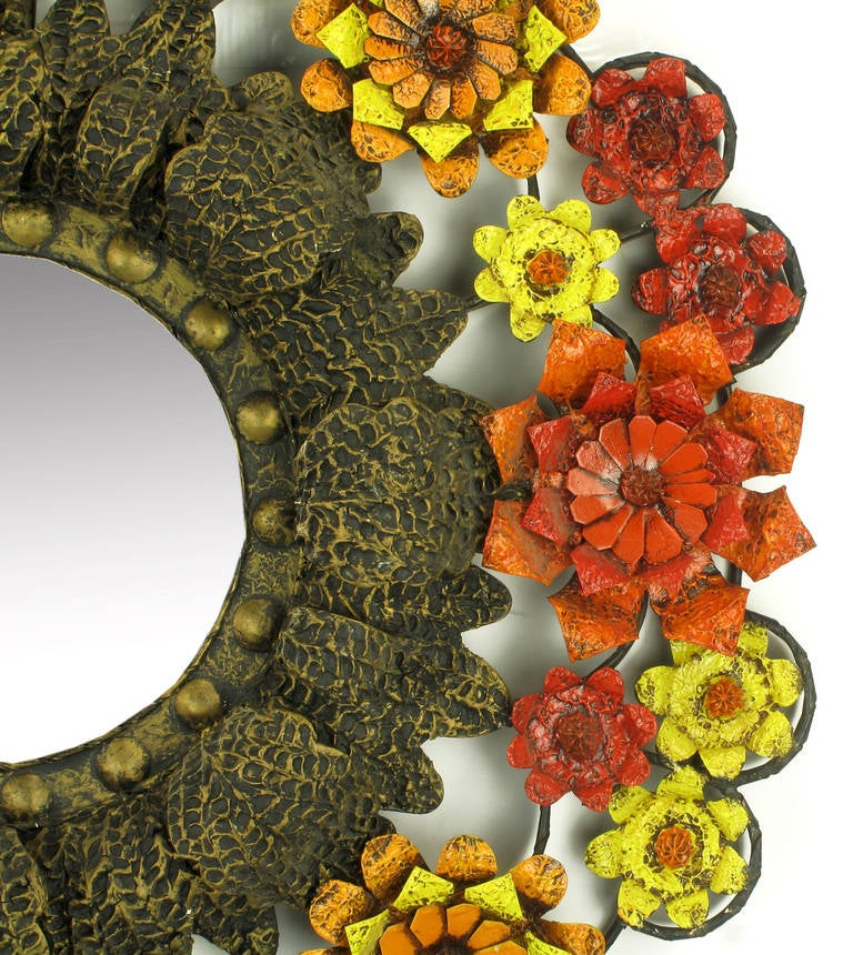 Fantastically uncommon flower encircled mirror of lacquered tole metal and gesso. Open frame work with depth and relief floral detail. 