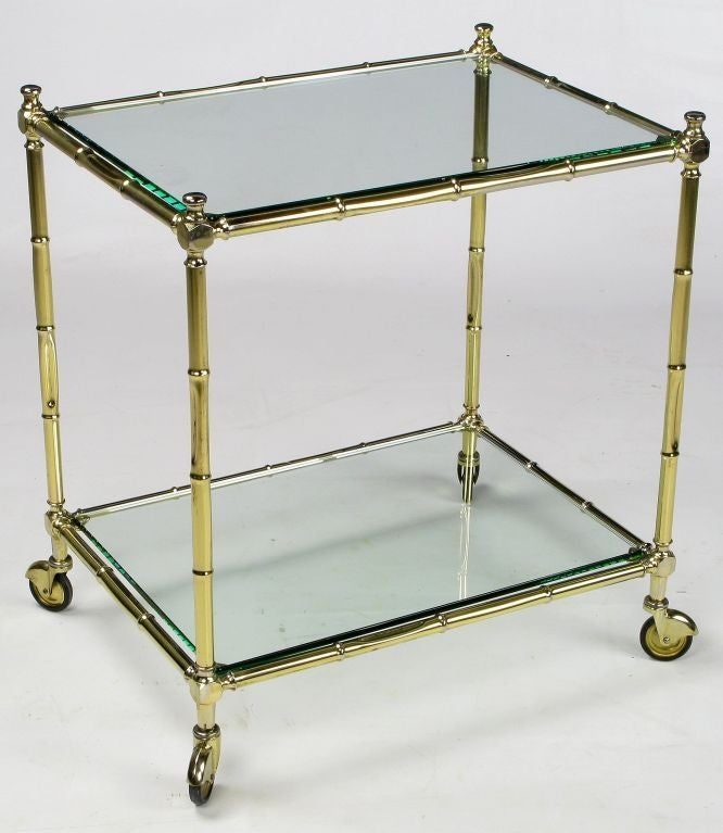 Excellent brass bar cart or table in faux bamboo with casters and new glass. This piece could also make a wonderful low server, or an end table if used without the casters.