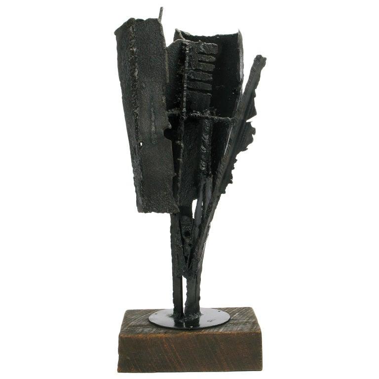 H i gates brutalist metal abstract sculpture on wood base