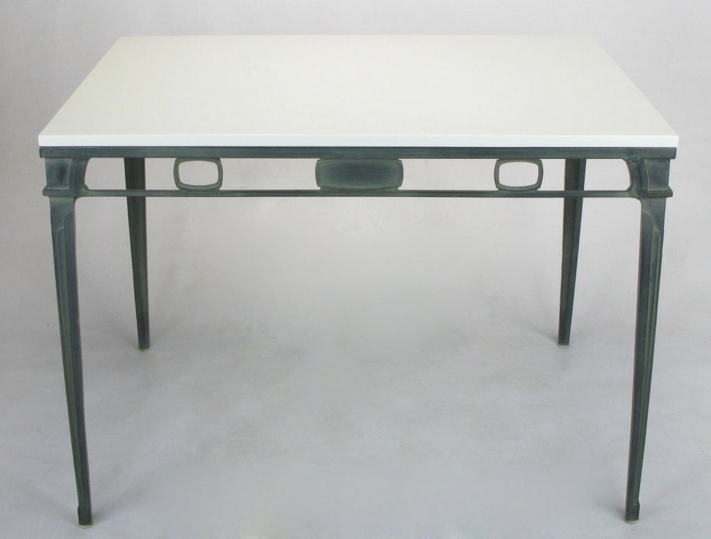Cast and lacquered aluminum art deco inspired petite dining table. Verdigris lacquered finish has the look of patinated bronze. White porcelain top is more durable and stain-resistant than the Thassos marble from which it is inspired, yet has the