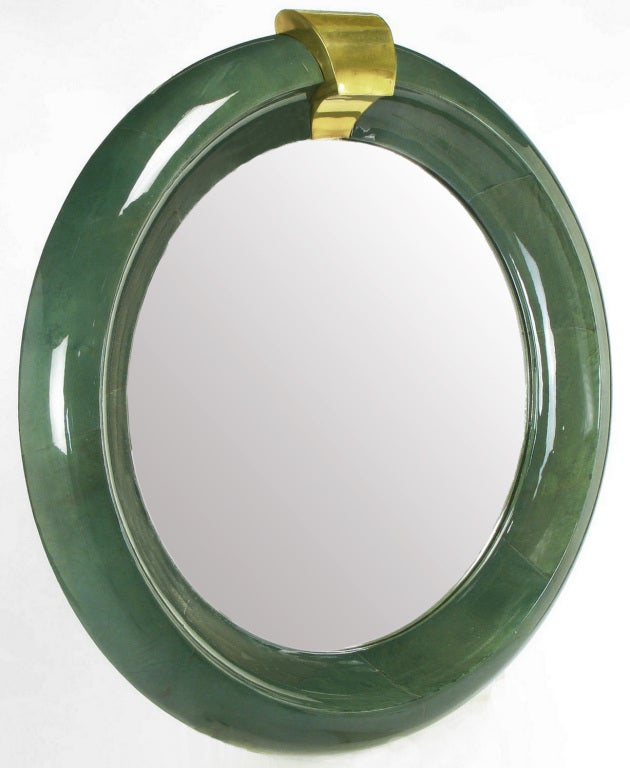 Palatial round mirror in a concave moss lacquered goat skin frame with brass