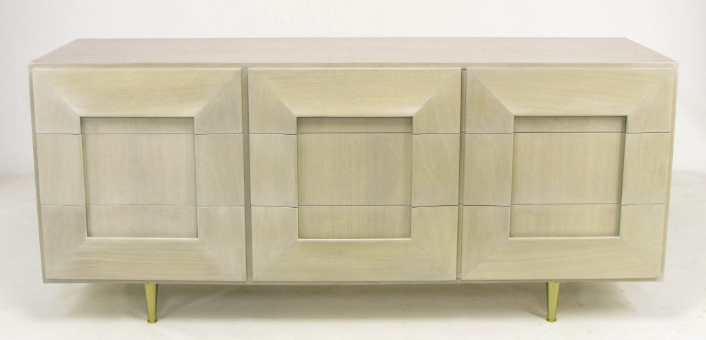 Bleached mahogany with a gray and white driftwood glaze six drawer dresser. Triple picture frame front with recessed panels appears to be a nine drawer dresser but is actually three double width drawers and three single width drawers. Brushed brass