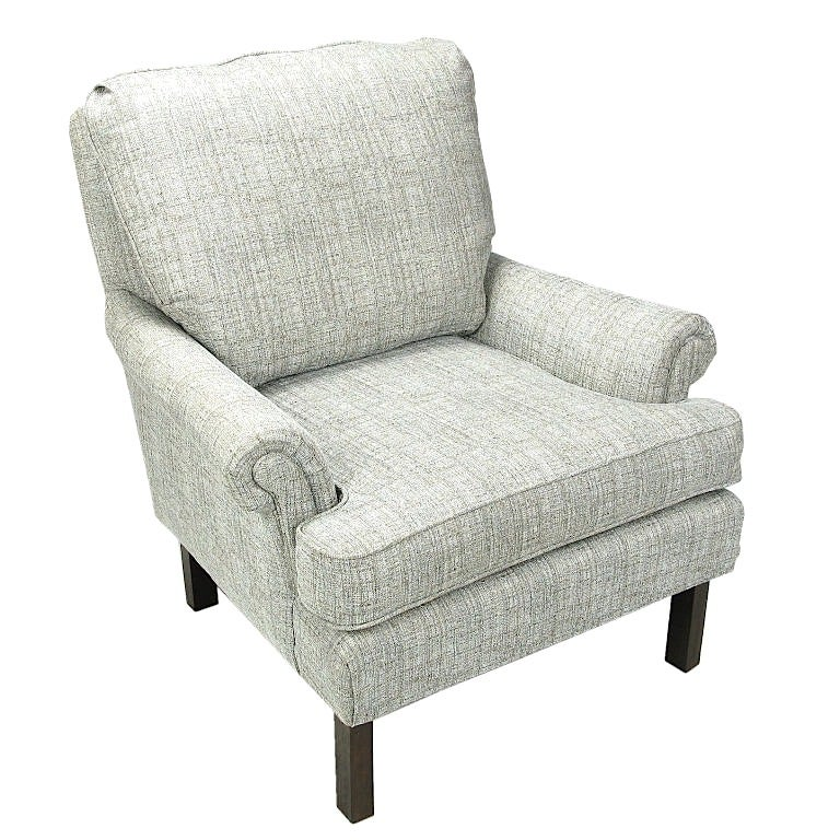 Single lounge chair in dove grey heathered linen. Custom built with dark stained clean lined legs, rolled arms and loose cushions. Similar to early Edward Wormley designs for Dunbar.