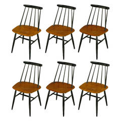 Six Ilmari Tapiovaara Teak and Black Lacquer Dining Chairs
