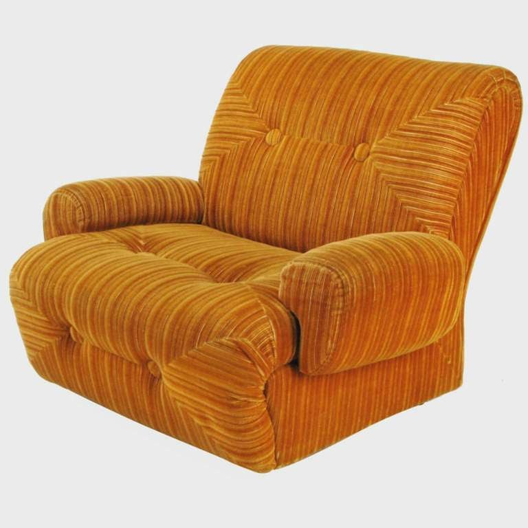 Chunky art deco revival club chair, in orange striped cut velvet upholstery, with oversize button-tufted seat and back. Arms are removable (see image 8), turning it into a sizable slipper chair. Brushed aluminum legs.