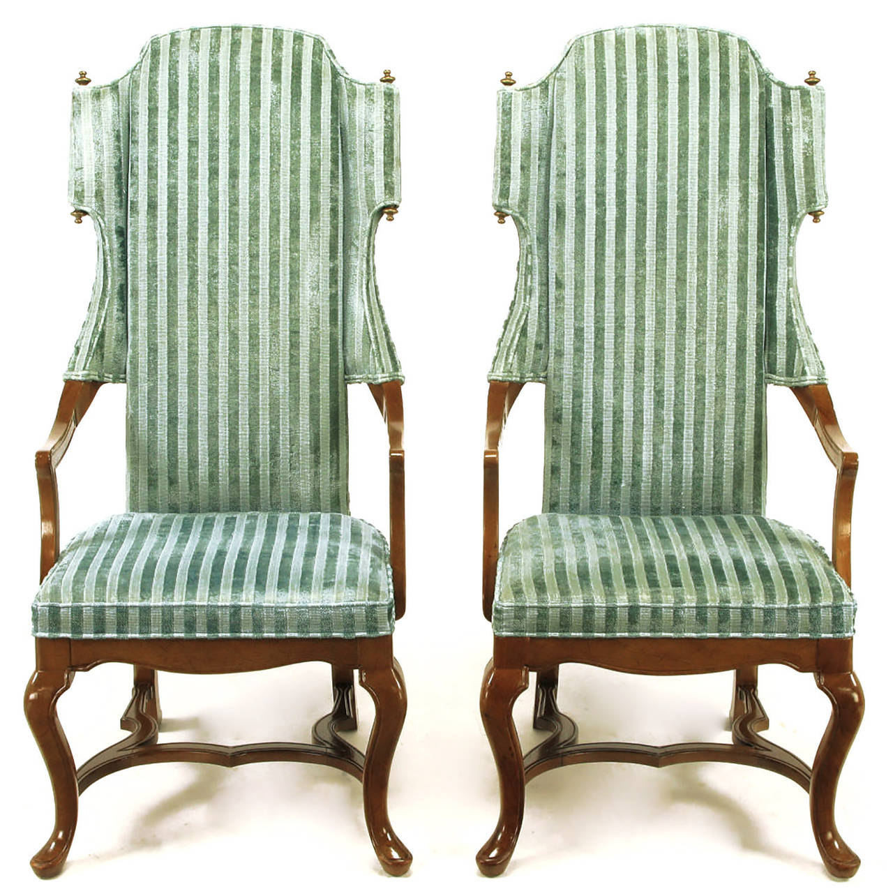 Tall back armchairs by Jim Peed for his Esperanto collection for Drexel. Open sides and unexpected scrolled wings with top and bottom brass finials. Walnut frames with cabriole front legs, raked rear legs and undulating H-form stretcher. Upholstered