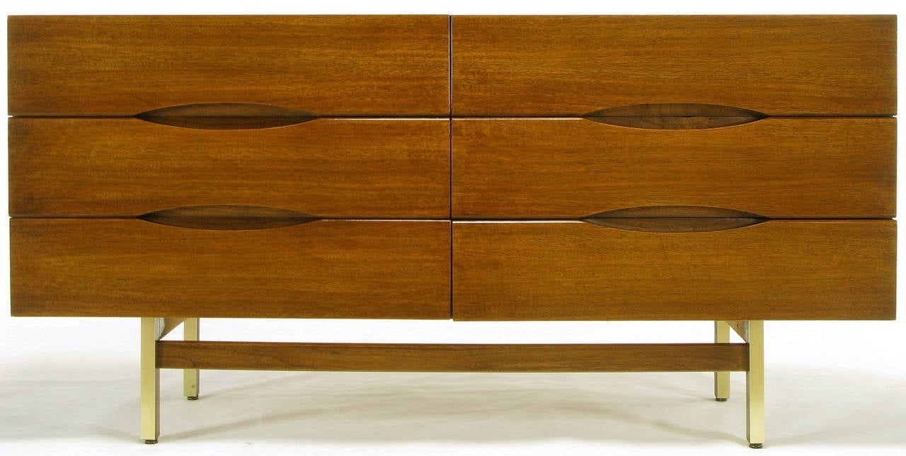 Clean lined six-drawer dresser form American of Martinsville. Elliptical inset drawer openings and four brass-clad mahogany deeply recessed legs with high set mahogany stretchers.