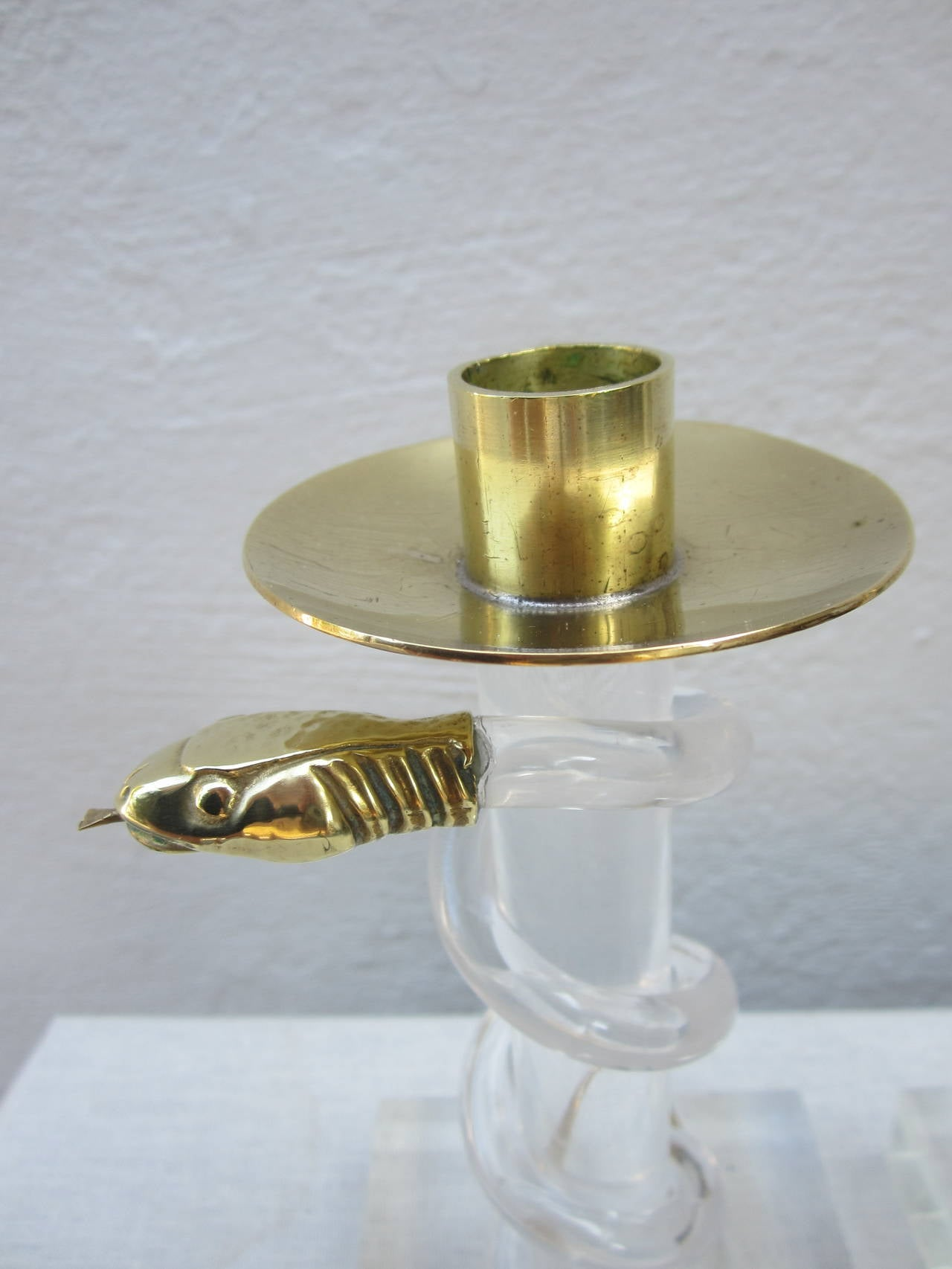 Exotic pair of Lucite and brass snake candlesticks by Allesandro Albrizzi.