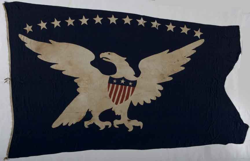 Thirteen-star 14 foot wide eagle American ship swallow-tailed pennant flag.  An extremely rare surviving example of historic flags used on American ships, this swallow-tailed flag would have flown from the main mast of the ship.  Thirteen handsewn