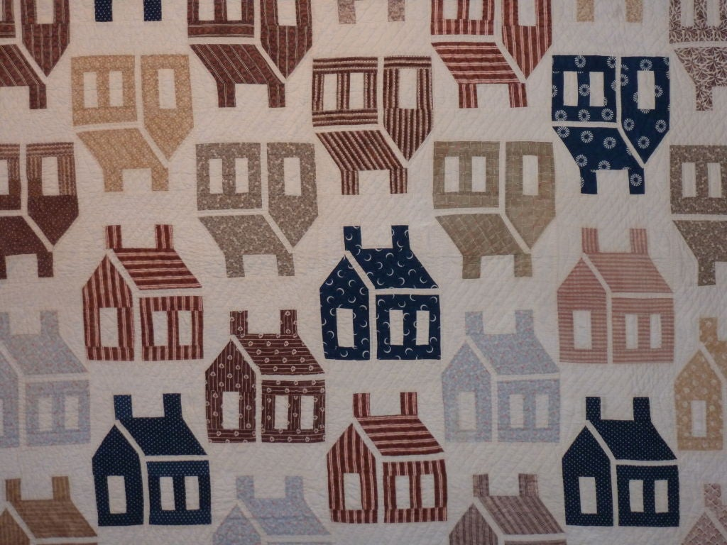 More than three dozen one-room schoolhouses are depicted here in a myriad of period prints.  More often pieced in one solid color on a white background, this is an unusual example of this collectible pattern.  The graphic simplicity of the piecework