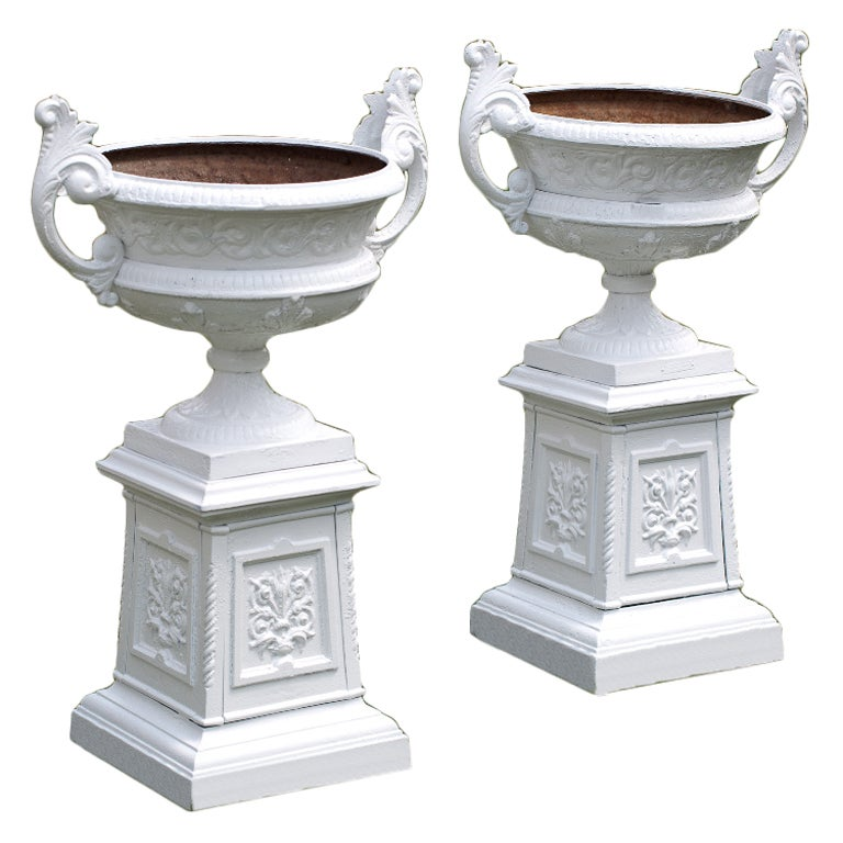 A Pair Of Urns On Pedestals At 1stdibs
