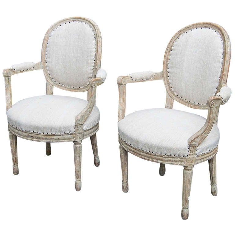 A pair of Swedish Gustavian period armchairs circa 1800.