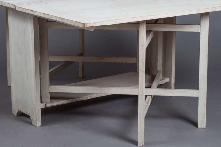 A Swedish drop leaf dining table circa 1840. image 3